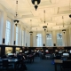 collegiate library with white ceiling and black lamps