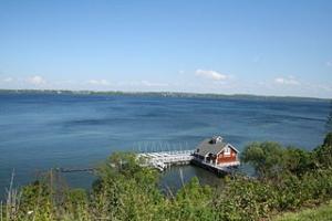 Red boathouse on lake