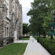 Pathway on college campus with gothic building on left
