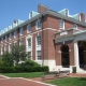 Large red brick building with white accents at Johns Hopkins University