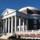 large red brick rotunda with white columns at front