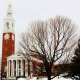 Large red brick colonial clocktower in the snow