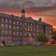 Red Brick building overlooking a quad during sunset