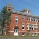 Large red brick building with white windowsills and trim