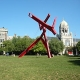 Large grass lawn with red modern sculpture