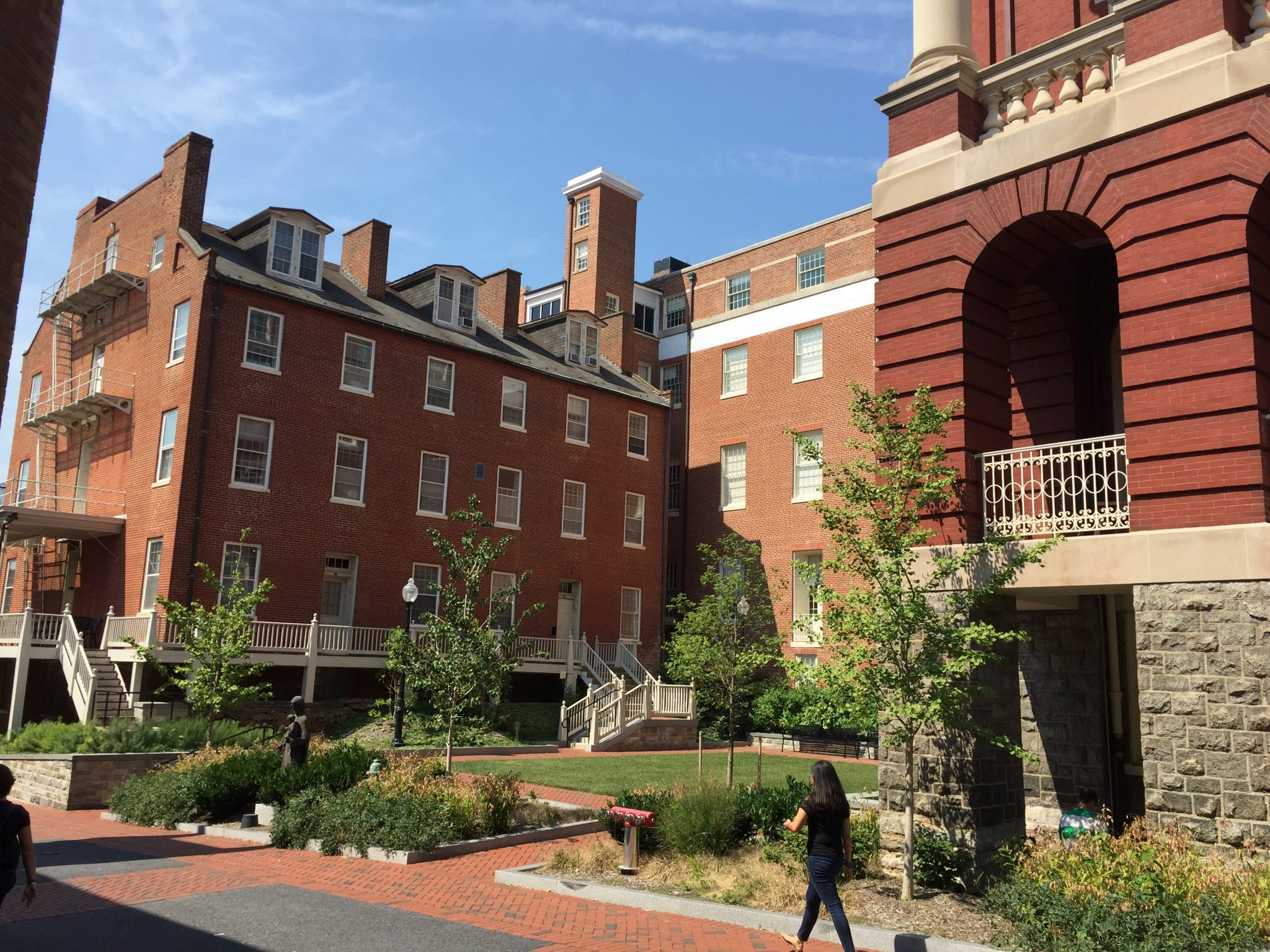 Large red brick building on college campus