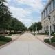 Light grey stone sidewalk and building on Texas Christian University's campus